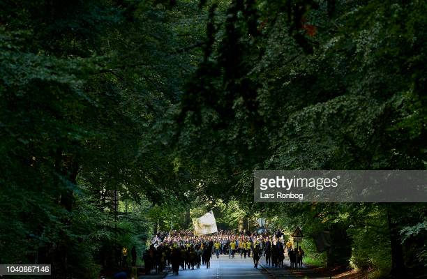 Fans of Brondby IF walking in the woods on their way to the stadium prior to the Danish Superliga match between AGF Aarhus and Brondby IF at Ceres...