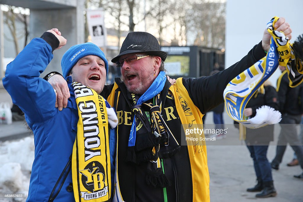 Fans of BSC Young Boys (R) and Everton FC sing prior to the UEFA Europa League Round of 32 match between BSC Young Boys and Everton FC at Stade de Suisse, Wankdorf on February 19, 2015 in Bern, Switzerland.