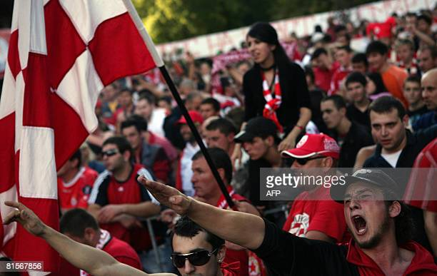 Fans of Bulgarian football team CSKA Sofia shout slogans some of them making Nazi salute during a protest in Sofia on June 14 2008 Several hundred...