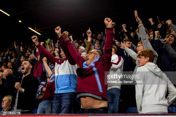 Fans of Burnley celebrate at full time during the UEFA Europa League Third Round Qualifier: Second Leg metch between Burnley and Istanbul Basaksehir...