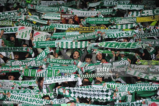 Fans of Bursaspor show their support during the UEFA Champions League Group C match between Bursapor Kulubu and Manchester United at the Bursa...