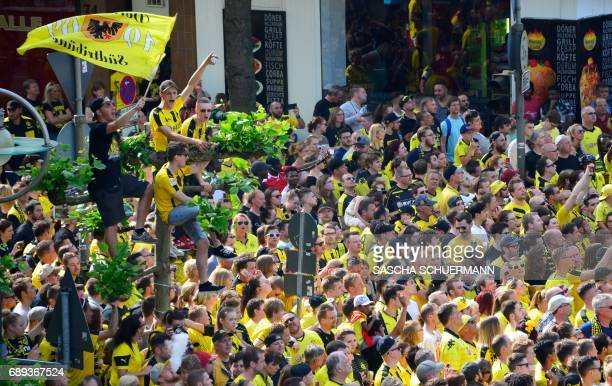 Fans of BVB Borussia Dortmund wait for the arrival of their team at Borsigplatz ahead of celebrations after winning the German Cup final in Dortmund...