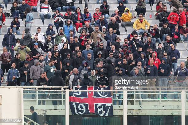 Fans of Cagliari Calcio cheer for their team during the Serie A match between ACF Fiorentina and Cagliari at Stadio Artemio Franchi on October 21...
