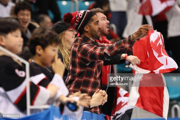Fans of Canada cheer during the game against Germany during the Men's Playoffs Semifinals on day fourteen of the PyeongChang 2018 Winter Olympic...