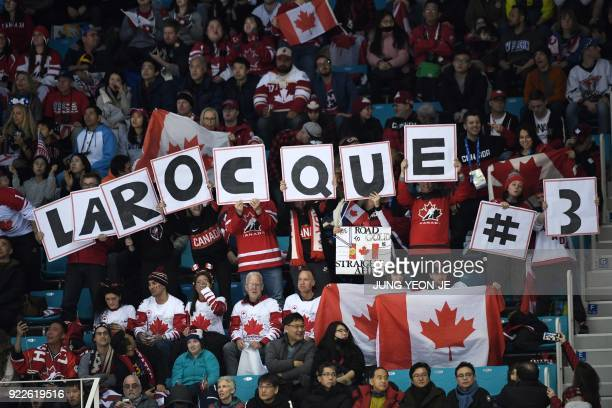 Fans of Canada's Jocelyne Larocque cheer her on in the women's gold medal ice hockey match between the US and Canada during the Pyeongchang 2018...