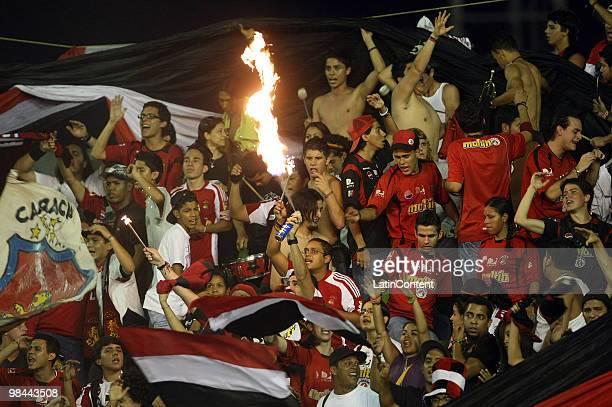 1f966ac8a18b Fans of Caracas Football Club cheer their team up against Universidad de  Chile during a Copa