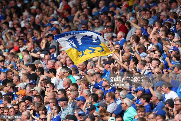 Fans of Cardiff City wave a flag during the Premier League match between Cardiff City and Arsenal FC at Cardiff City Stadium on September 2 2018 in...