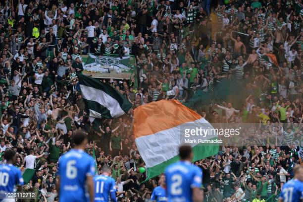 Fans of Celtic celebrates after Olivier Ntcham of Celtic scored their team's first goal during the Scottish Premier League match between Celtic and...