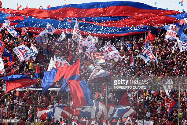 Fans of Cerro Porteno cheer for their team before the start of their Paraguayan Apertura 2016 football tournament match against Olimpia at the...