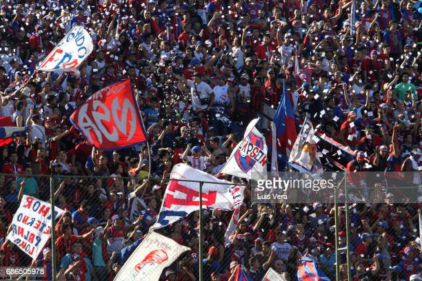 Fans of Cerro Porteño cheer for their team during a match between Olimpia and Cerro Porteño as part of the 17th round of Torneo Apertura 2017 at...