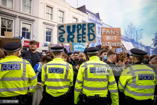 Fans of Chelsea Football Club protest against the European Super League outside Stamford Bridge on April 20, 2021 in London, England. Six English...