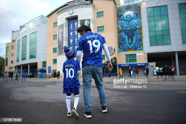Fans of Chelsea make their way towards the stadium ahead of the Premier League match between Chelsea and Leicester City at Stamford Bridge on May 18,...