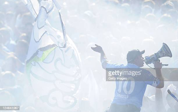 Fans of Chemnitz cheer during the Third League match between Carl-Zeiss Jena and Chemnitzer FC at Ernst-Abbe-Sportfeld stadium on September 11, 2011...
