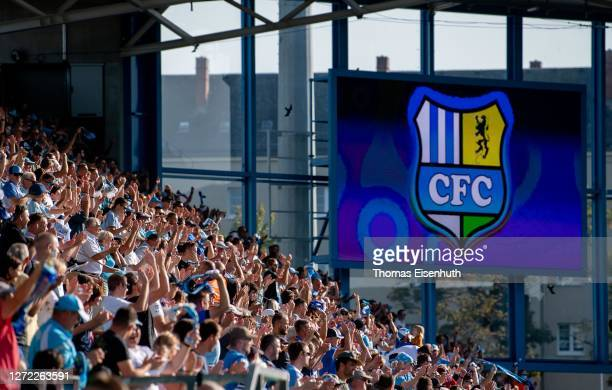 Fans of Chemnitzer FC celebrate their team's first goal during the DFB Cup first round match between Chemnitzer FC and TSG Hoffenheim at Stadion an...