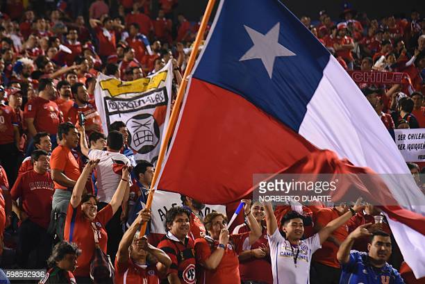 Fans of Chile cheer as they wait for the start of the FIFA World Cup 2018 qualifier football match between Paraguay and Chile in Asuncion Paraguay on...