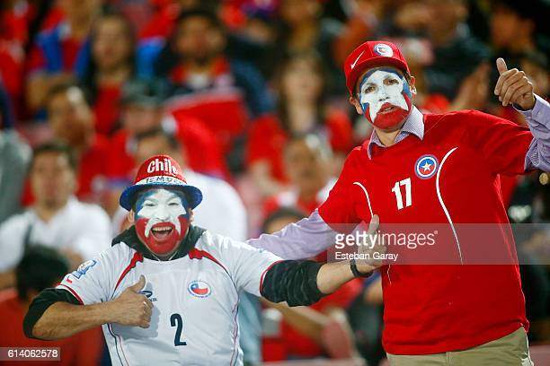 Fans of Chile cheer for their team before a match between Chile and Peru as part of FIFA 2018 World Cup Qualifiers at at Nacional Stadium on October...