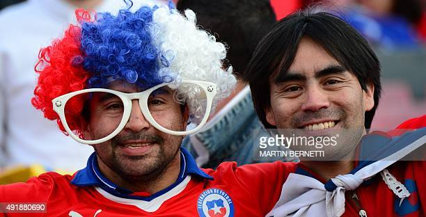 Fans of Chile cheer for their team before the start of the Russia 2018 FIFA World Cup South American qualifier match against Brazil in Santiago on...