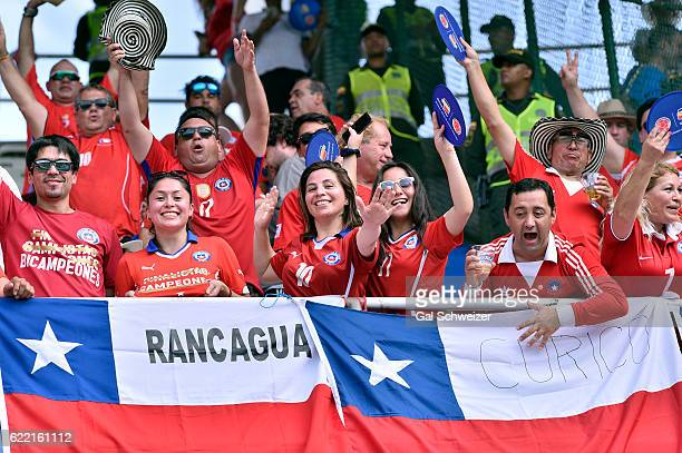Fans of Chile cheer for their team during a match between Colombia and Chile as part of FIFA 2018 World Cup Qualifiers at Metropolitano Roberto...