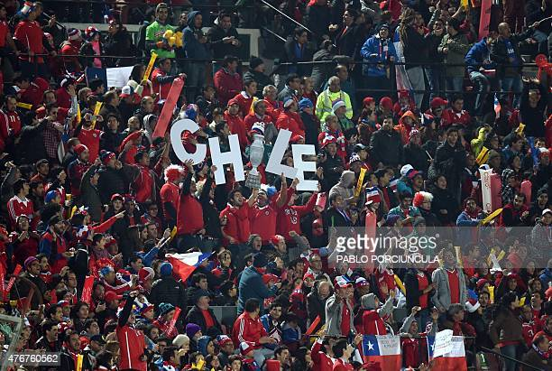 Fans of Chile cheer for their team during the Copa America inauguration football match against Ecuador on June 11 2015 at the Nacional stadium in...