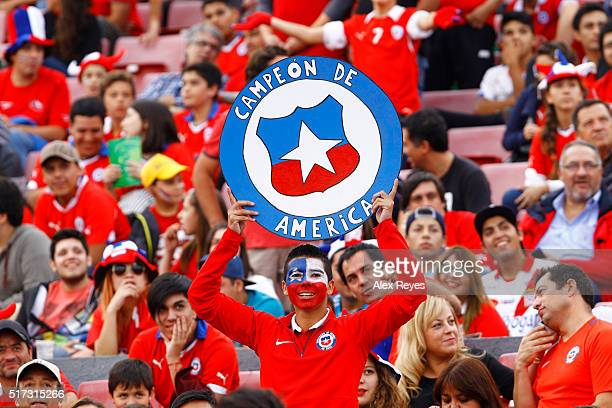 Fans of Chile cheer for their team prior to a match between Chile and Argentina as part of FIFA 2018 World Cup Qualifiers at Nacional Stadium on...