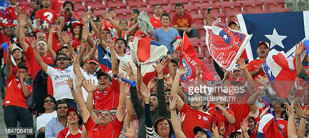 Fans of Chile cheer their team before the start of their Brazil 2014 FIFA World Cup South American qualifier match against Ecuador at the National...