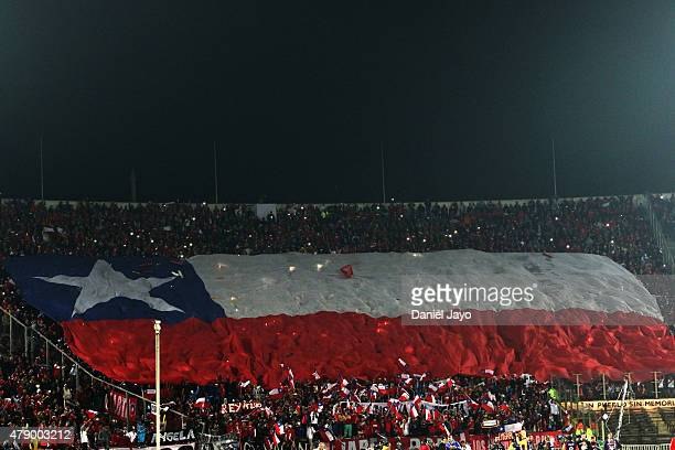 Fans of Chile display a big Chilean flag to cheer their team during the 2015 Copa America Chile Semi Final match between Chile and Peru at Nacional...