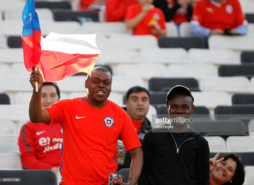 Fans of Chile enjoy the atmosphere prior to a match between Chile and Paraguay as part of FIFA 2018 World Cup Qualifiers at Monumental Stadium on August 31, 2017 in Santiago, Chile.