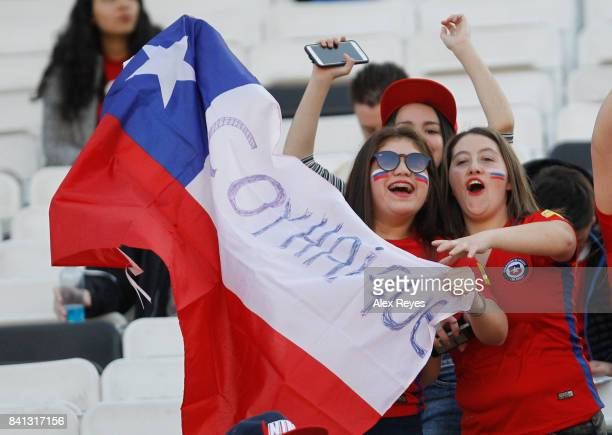 Fans of Chile enjoy the atmosphere prior to a match between Chile and Paraguay as part of FIFA 2018 World Cup Qualifiers at Monumental Stadium on...