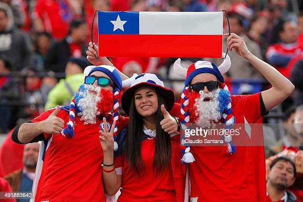 Fans of Chile pose before a match between Chile and Brazil as part of FIFA 2018 World Cup Qualifier at Estadio Nacional on October 08 2015 in...