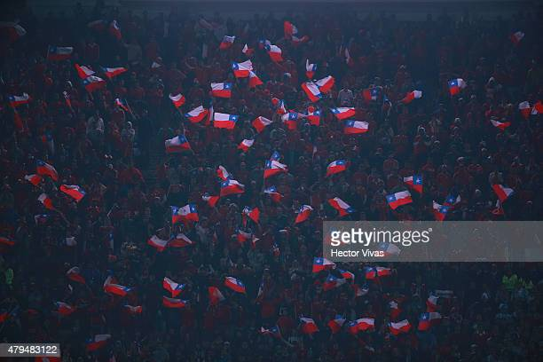 Fans of Chile wave Chilean flags to cheer for their team during the 2015 Copa America Chile Final match between Chile and Argentina at Nacional...
