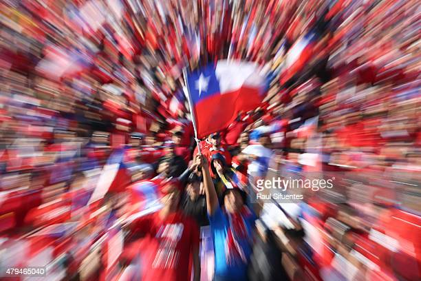 Fans of Chile wave Chilean flags to cheer for their team prior the 2015 Copa America Chile Final match between Chile and Argentina at Nacional...