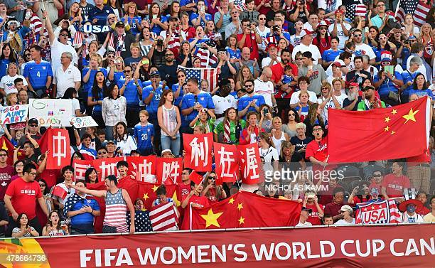 Fans of China and the US cheer before their 2015 FIFA Women's World Cup quarterfinal match between the US and China at Lansdowne Stadium in Ottawa...