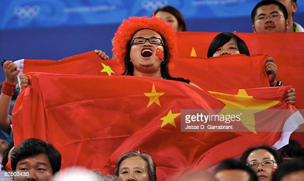 Fans of China cheer against Australia during the Women's Semifinals basketball game at the Wukesong Indoor Stadium during Day 13 of the Beijing 2008...