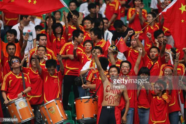 Fans of China cheer during the quarter final match of FIFA Women's World Cup China 2007 between China and Norway at Wuhan Sports Center Stadium on...