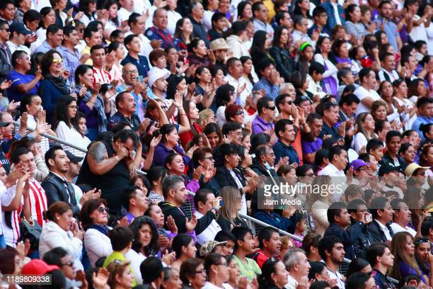Fans of Chivas appalud during a mass in memory of former owner of Chivas Jorge Vergara at Akron Stadium on November 24 2019 in Zapopan Mexico