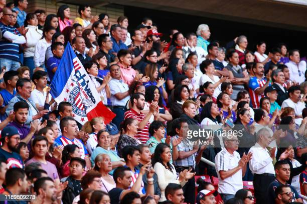 Fans of Chivas applaud during a mass in memory of former owner of Chivas Jorge Vergara at Akron Stadium on November 24 2019 in Zapopan Mexico