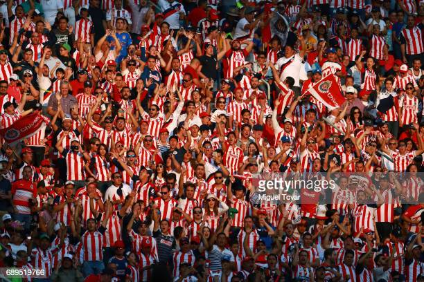 Fans of Chivas celebrate the second goal of their team during the Final second leg match between Chivas and Tigres UANL as part of the Torneo...