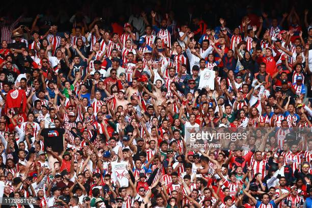 Fans of Chivas cheer during the 17th round match between Toluca and Chivas as part of the Torneo Apertura 2019 Liga MX at Nemesio Diez Stadium on...