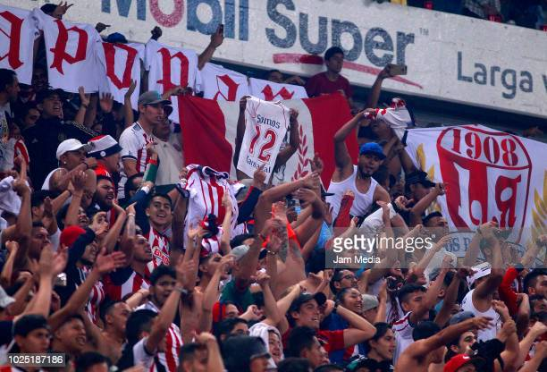 Fans of Chivas cheer during the 7th round match between Atlas and Chivas as part of the Torneo Apertura 2018 Liga MX at Jalisco Stadium on August 24...