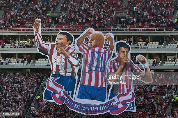 Fans of Chivas cheer for their team before the 10th round match between Chivas and America as part of the Clausura 2016 Liga MX at Chivas Stadium on...