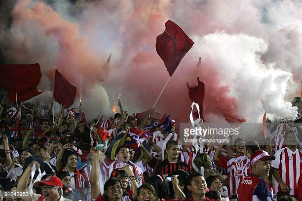 Fans of Chivas de Guadalajara celebrate a goal with smoke bombs and fireworks in the second half during the International Club Friendly match between...