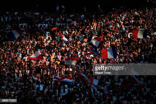 Fans of chivas wave flags during the Final second leg match between Chivas and Tigres UANL as part of the Torneo Clausura 2017 Liga MX at Chivas...