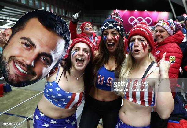 Fans of Chris Mazdzer of the United States including his girlfriend Mara Marian react following his third run during the Luge Men's Singles on day...