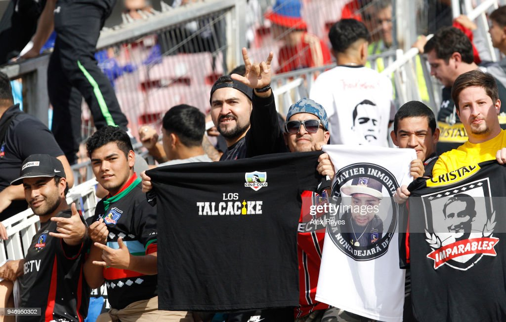 Fans of Colo Colo cheer for their team during a match between U de Chile and Colo Colo as part of Torneo Scotiabank 2018 at Nacional Stadium of Chile on April 15, 2018 in Santiago, Chile.