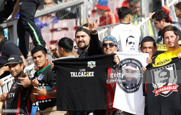 Fans of Colo Colo cheer for their team during a match between U de Chile and Colo Colo as part of Torneo Scotiabank 2018 at Nacional Stadium of Chile...
