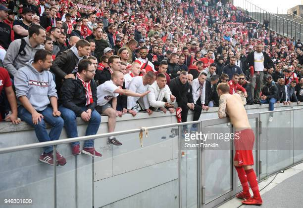 Fans of Cologne make their feelings know to Marcel Risse of Cologne after the Bundesliga match between Hertha BSC and 1 FC Koeln at Olympiastadion on...