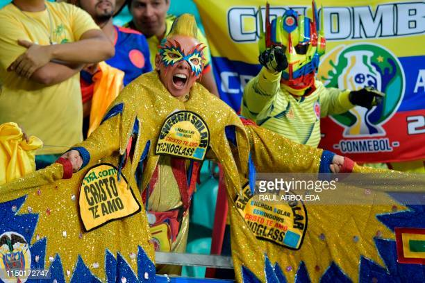 Fans of Colombia cheer before the start of the Copa America football tournament group match against Argentina at the Fonte Nova Arena in Salvador...