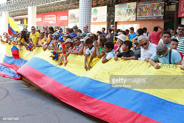Fans of Colombia cheer for their team as the head on for a training session at Universidad de Fortaleza Stadium on July 03 2014 in Fortaleza Brazil...