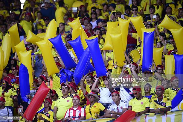 Fans of Colombia cheer for their team before the start of the Russia 2018 FIFA World Cup qualifiers match Colombia vs Peru at the Metropolitano...