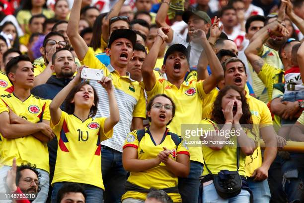 Fans of Colombia cheer for their team during a friendly match between Peru and Colombia at Estadio Monumental de Lima on June 9 2019 in Lima Peru